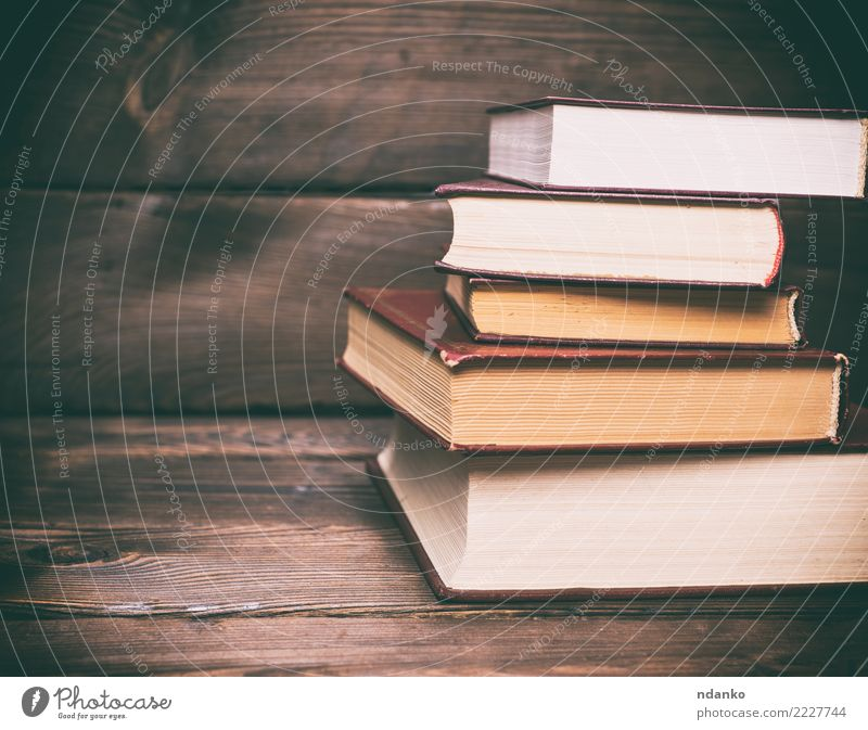 stack of closed books Reading Table Education School Academic studies Book Paper Wood Old Retro Brown White Idea background vintage wall Consistency Grunge