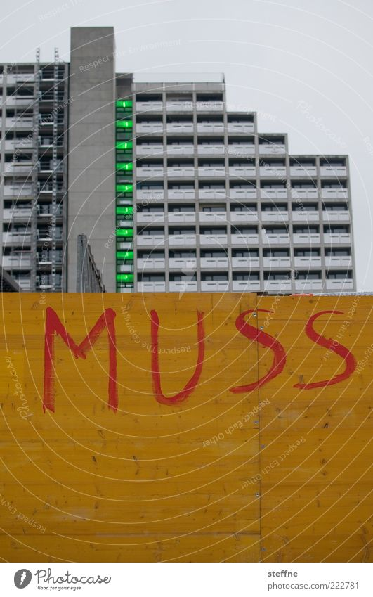 City House (Residential Structure) Wall (building) Wall (barrier) Architecture Facade High-rise Gloomy Munich Typography Text Must Wooden wall Tower block Capital letter Hoarding