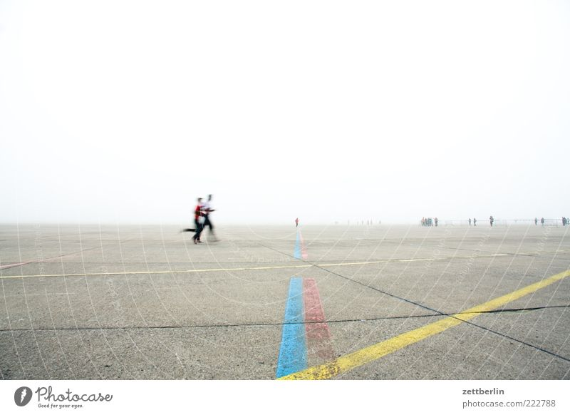 be in progress Far-off places Fitness Sports Training Sportsperson Jogging Human being Group Fog Airport Airfield Walking Berlin Marker line Signs and labeling