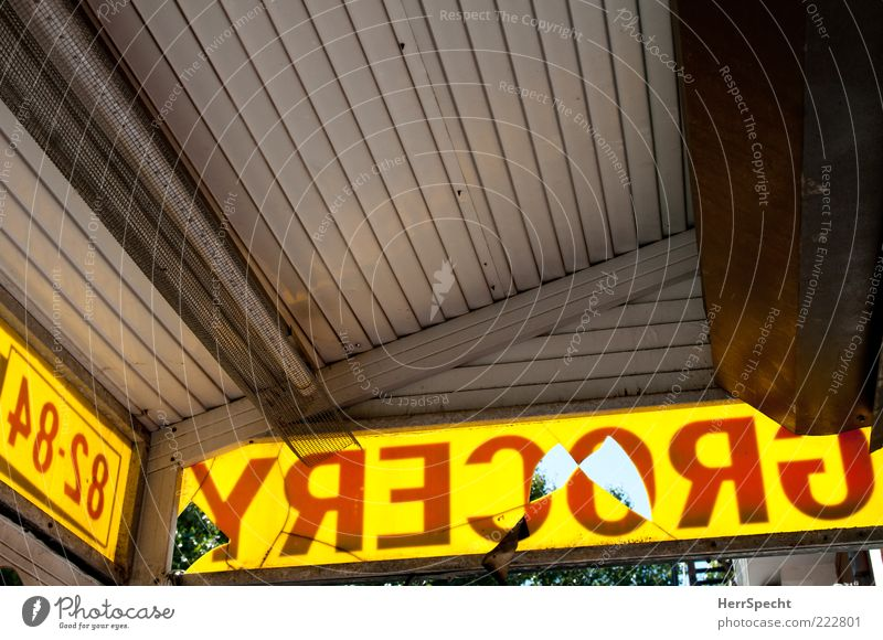 Grocery Store Characters Signs and labeling Old Broken Gloomy Yellow Gray Red Supermarket Canopy Hollow Perforated Letters (alphabet) inversely Brooklyn Trashy