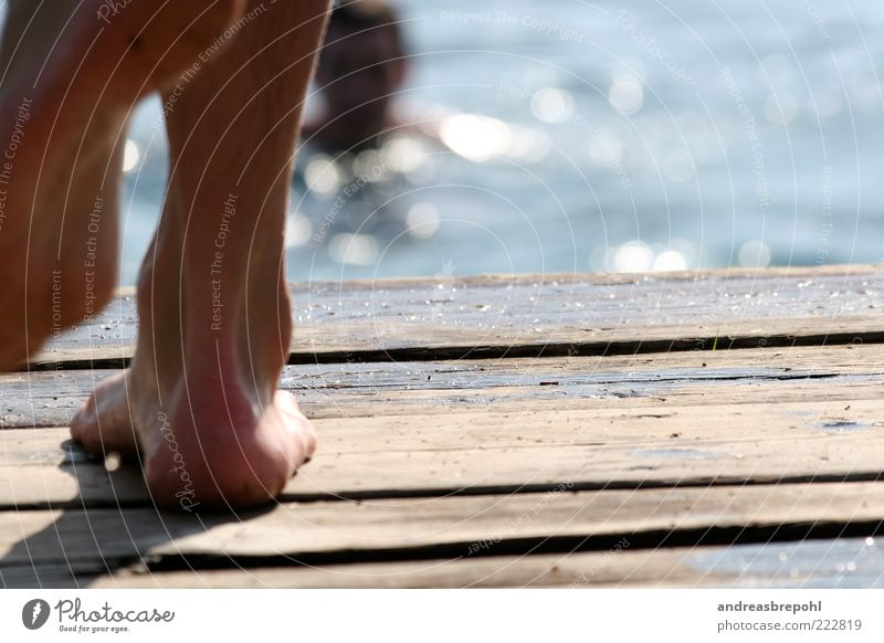 Human being Summer Adults Wood Legs Feet Going Wet Swimming & Bathing Masculine 18 - 30 years Footbridge Summer vacation Summery Sole of the foot Blur