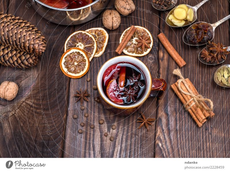 mulled wine in a brown cup Fruit Herbs and spices Beverage Alcoholic drinks Mulled wine Cup Spoon Decoration Table Feasts & Celebrations Christmas & Advent