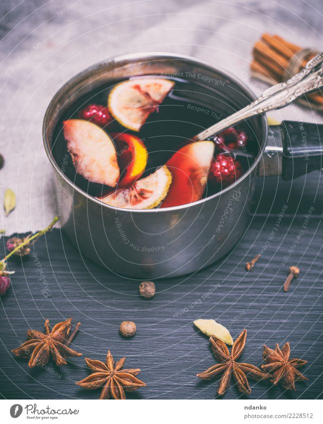 mulled wine in an aluminum ladle Christmas & Advent Red Winter Wood Feasts & Celebrations Above Decoration Table Herbs and spices Beverage Hot Apple Tradition