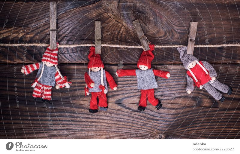 wooden dolls in winter clothes Christmas & Advent New Year's Eve Rope Toys Doll Wood Small Brown Red Hanging Clothes peg christmas background vintage Rustic