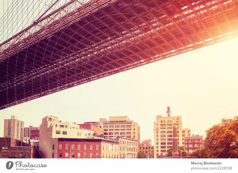 Under the Brooklyn Bridge at sunset. Town House (Residential Structure) Architecture Wall (building) Building Wall (barrier) Vantage point Authentic USA