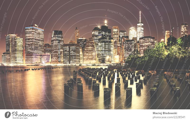 Vintage toned picture of Manhattan at night. Vacation & Travel Town Architecture Building Business Tourism Living or residing Retro High-rise Vantage point