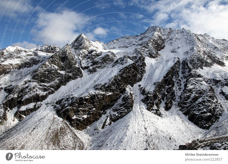 summit Landscape Sky Clouds Sunlight Autumn Beautiful weather Ice Frost Snow Rock Alps Mountain Snowcapped peak Glacier Esthetic Sharp-edged Gigantic Large Tall
