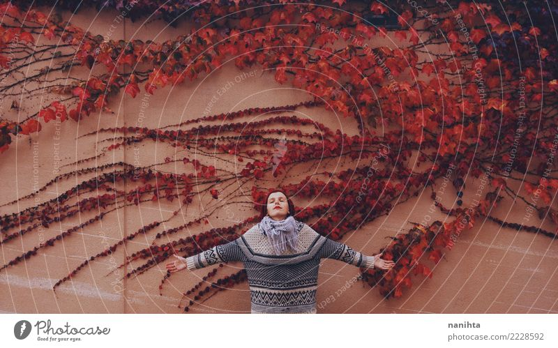 Young woman in a wall full of autumn leaves Design Wellness Harmonious Relaxation Human being Feminine Woman Adults Youth (Young adults) 1 18 - 30 years Nature