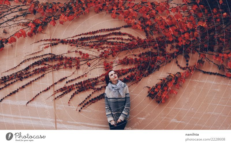 Young woman in a wall with red ivy Human being Nature Youth (Young adults) Plant Beautiful Red Leaf Winter 18 - 30 years Adults Lifestyle Wall (building) Autumn