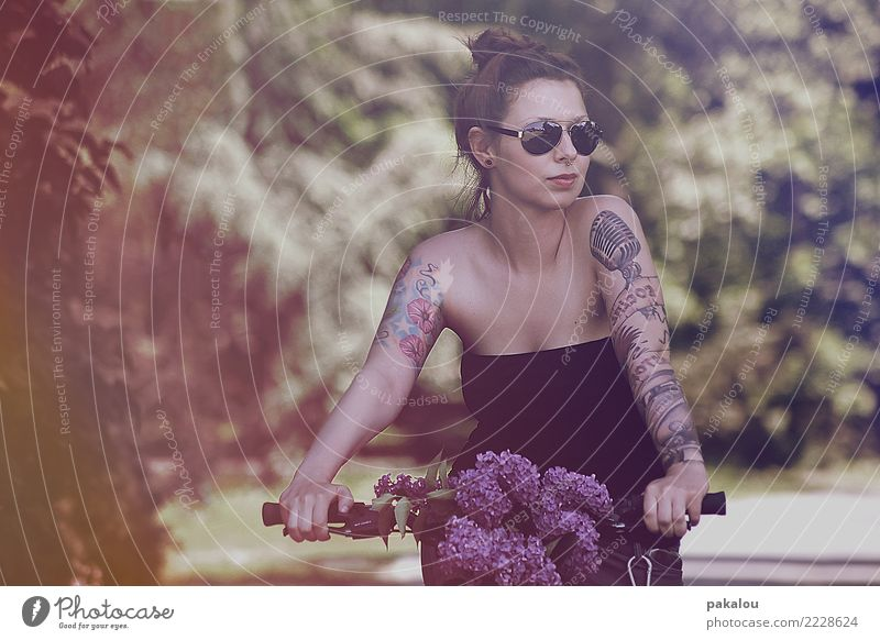 Do you hear the birds chirping? Cycling Feminine Woman Adults 1 Human being 18 - 30 years Youth (Young adults) Nature Plant Flower Park Bicycle Sunglasses