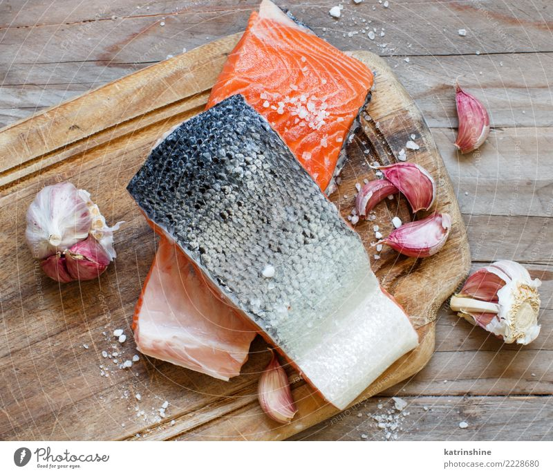 Fresh raw salmon on a wooden cutting board Seafood Vegetable Nutrition Eating Dinner Diet Table Above Red background cooking fillet fish healthy Ingredients