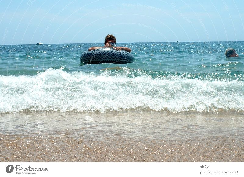 Man Ocean Vacation & Travel Photographer Take a photo Water wings