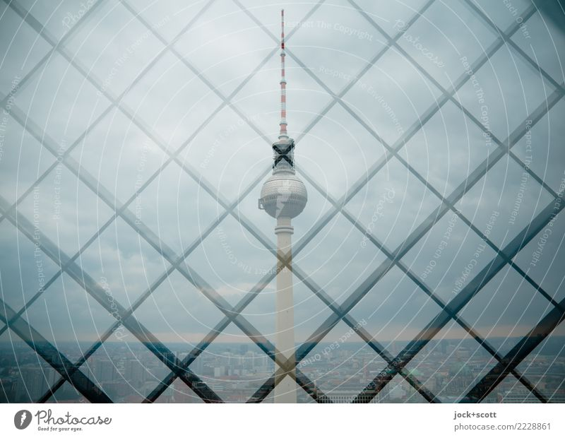 Tower in grid Tourist Attraction Landmark Berlin TV Tower Network Exceptional Sharp-edged Gray Safety Horizon Symmetry Double exposure Grid Metal grid Reaction