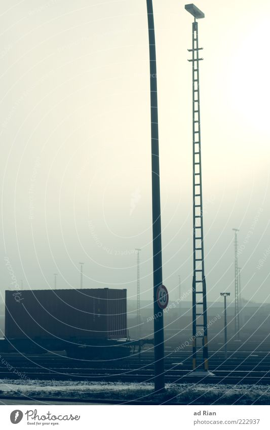 Cold Fog Signs and labeling Railroad Logistics Railroad tracks Electricity pylon Bad weather Container Means of transport Railroad car Rail transport