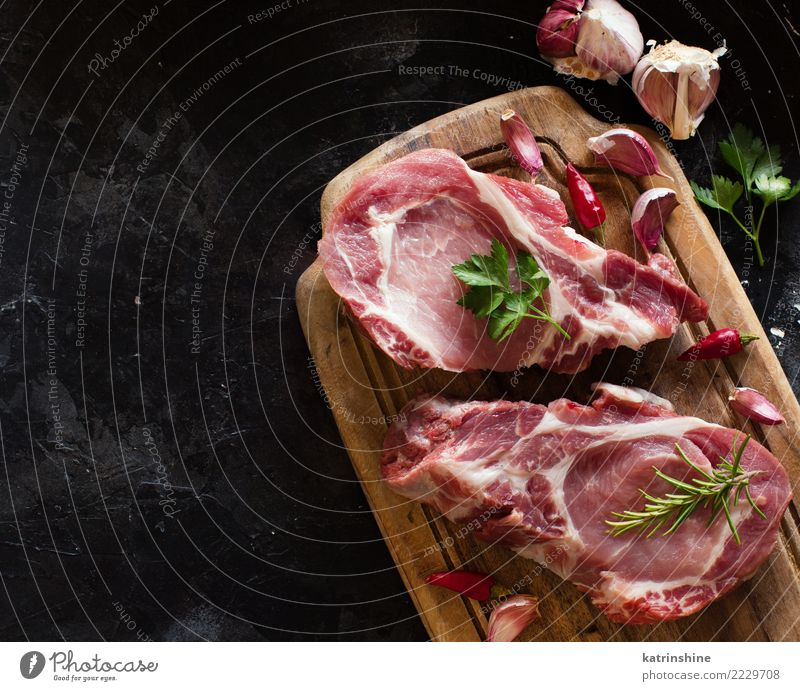 Raw pork steaks called capicola with vegetables and herbs Meat Vegetable Herbs and spices Nutrition Dinner Fresh Above Green Red capicolla board butcher cooking