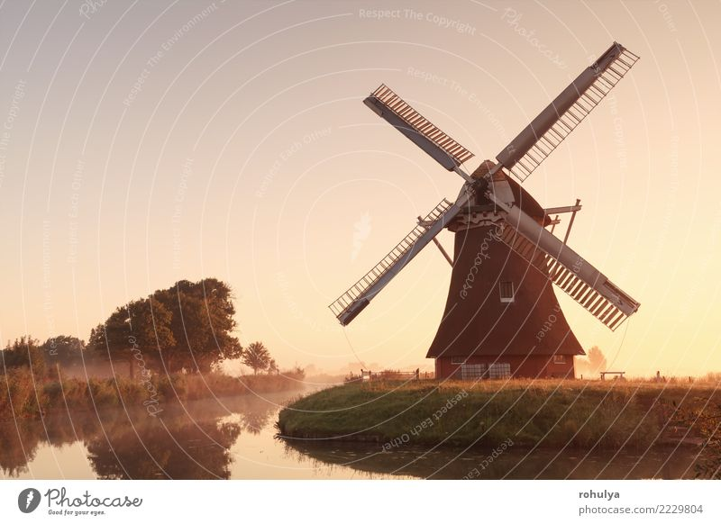 charming windmill by river at sunrise Vacation & Travel Culture Nature Landscape Sky Sunrise Sunset Sunlight Summer Beautiful weather Fog River Building