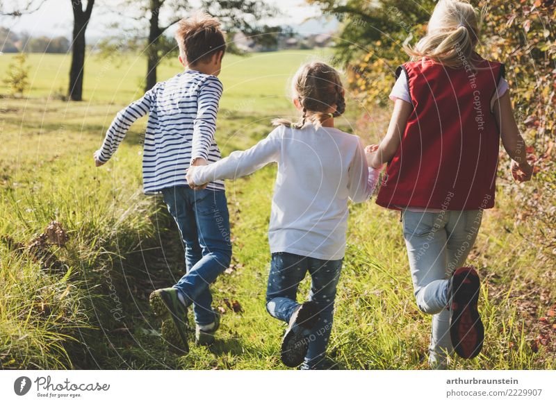 Children running in the meadow in autumn Lifestyle Healthy Athletic Leisure and hobbies Playing Vacation & Travel Tourism Trip Parenting Schoolchild Human being