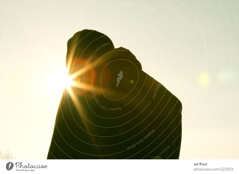 the sun is shining out of his... um. Mouth! Human being Back 1 Cloudless sky Sun Cold Colour photo Sunlight Sunbeam Worm's-eye view Silhouette Rear view Cap