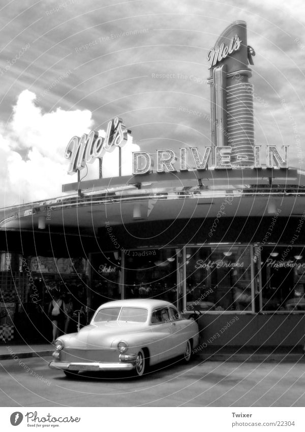 drive in USA Americas Vintage car Motor vehicle Parking lot Architecture Sky Clouds Vacation & Travel Past Gastronomy Car Fast food restaurant Exterior shot