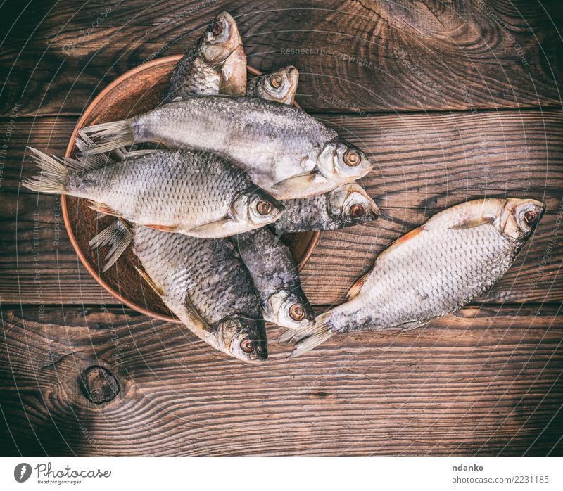 fish ramming in scales Fish Seafood Plate Group Animal Wood Eating Natural Above Brown Roach salted background dry Preparation Snack Gourmet board appetizer