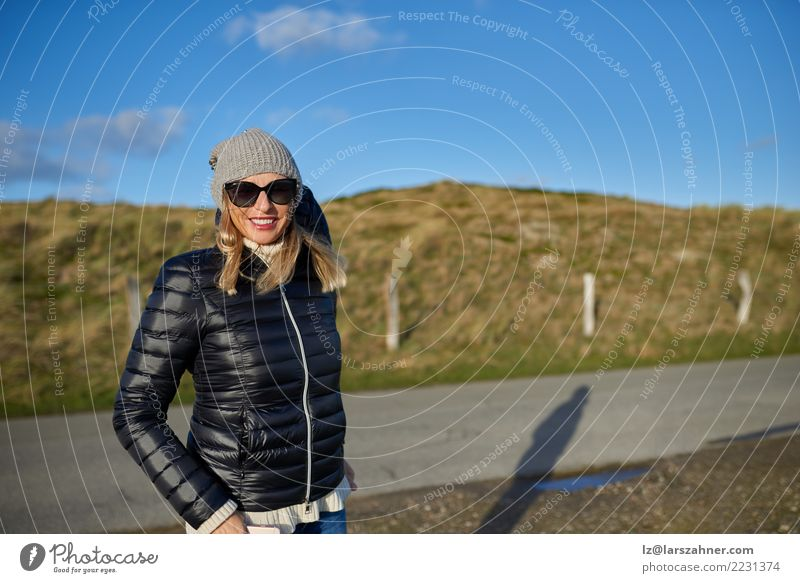 Trendy woman wearing a leather jacket Happy Contentment Woman Adults 1 Human being Landscape Autumn Street Fashion Jacket Sunglasses Blonde Smiling Stand