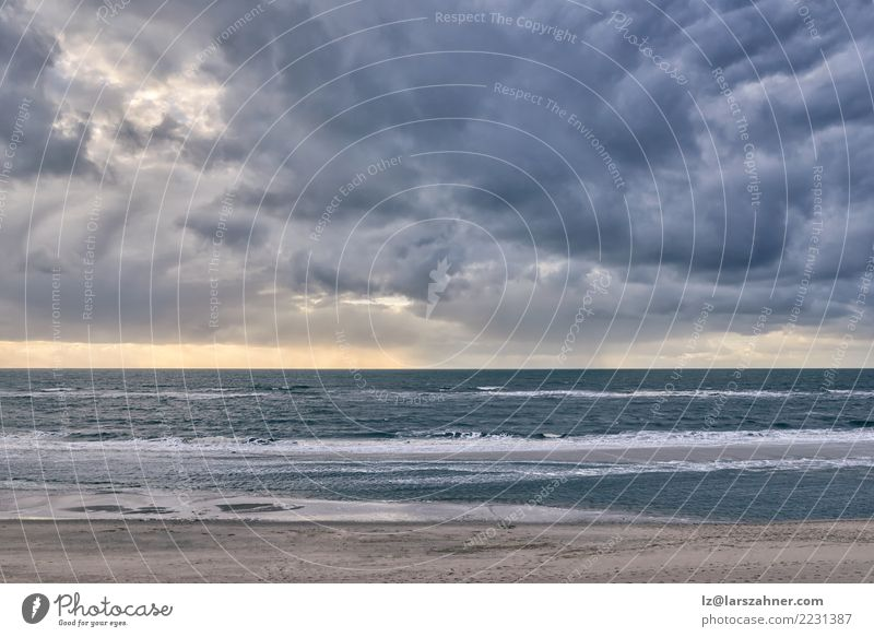 Dramatic seascape against cloudy sky at sunset Vacation & Travel Beach Ocean Waves Nature Landscape Sky Clouds Horizon Autumn Weather Storm Wind Coast