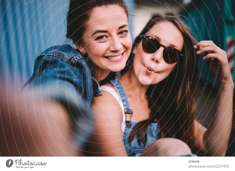 Two happy girlfriends taking selfie together Lifestyle Joy Happy Leisure and hobbies Camera Technology Woman Adults Friendship Youth (Young adults) Kissing