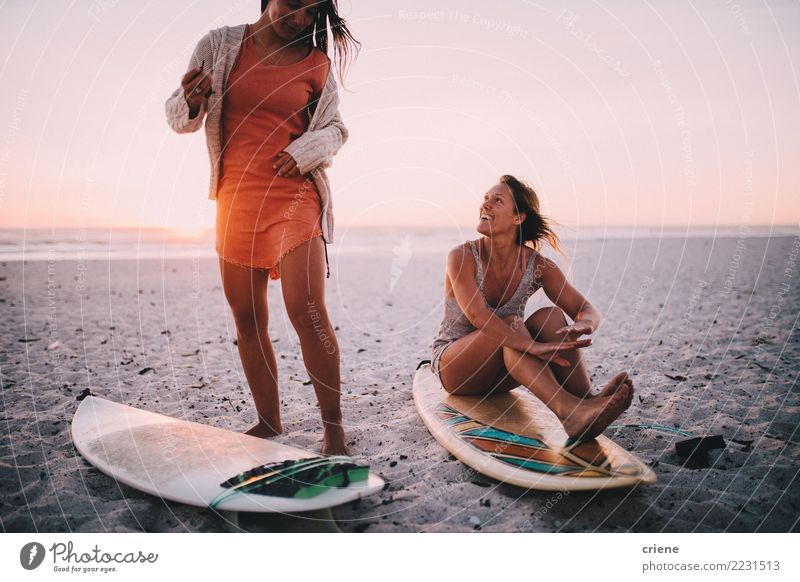 Two happy girlfriends having fun at the beach with surfboards Woman Vacation & Travel Youth (Young adults) Summer Relaxation Joy Beach Adults Lifestyle Feminine