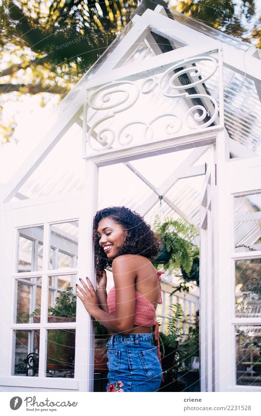 Portrait of smiling young african woman in greenhouse Woman Joy Adults Happy Smiling Tropical Greenhouse
