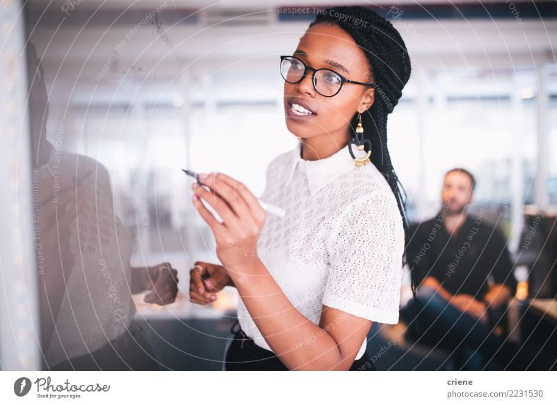 Young african businesswoman writing notes on whiteboard Success Internship Work and employment Office Financial Industry Business Meeting To talk Human being