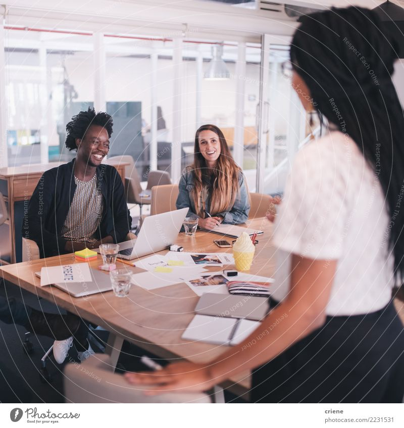 Startup office team in meeting room in a conversation Lifestyle Table Success Internship Work and employment Office Business Meeting To talk Human being
