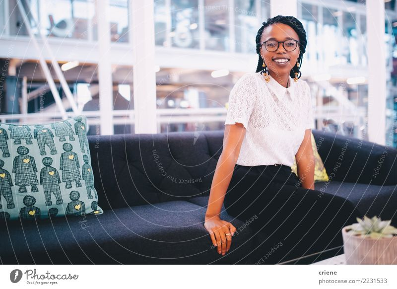 Portrait of smiling young african businesswoman in office Happy Success Work and employment Office Business Adults Afro Smiling Emotions Self-confident