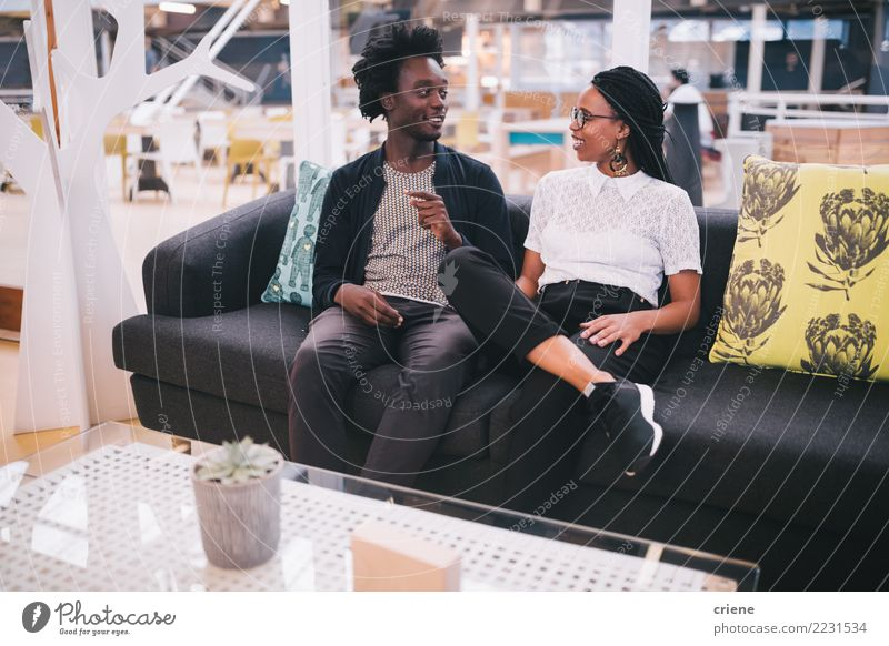 Young african businesspeople having conversation in office Lifestyle Sofa Work and employment Office Business Meeting To talk Feminine Youth (Young adults)