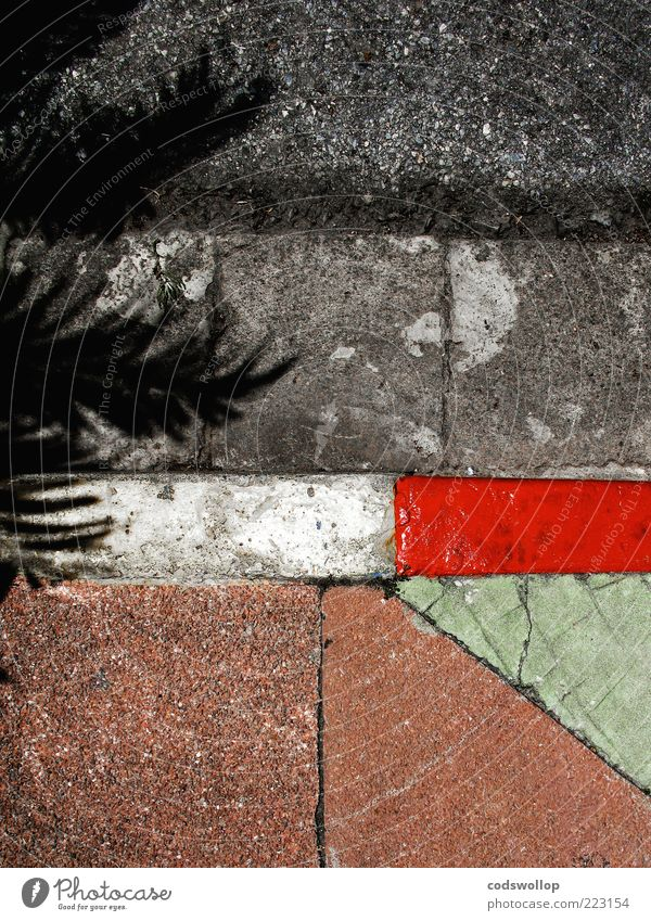 winter holidays on the roadside Street Sharp-edged Gray Green Red White Curbside Roadside Geometry Structures and shapes Sidewalk Pavement Colour photo