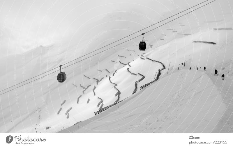 white happiness Vacation & Travel Snow Winter vacation Mountain Winter sports Landscape Clouds Bad weather Fog Alps Cable car Ski lift Dark Gigantic Gloomy Gray