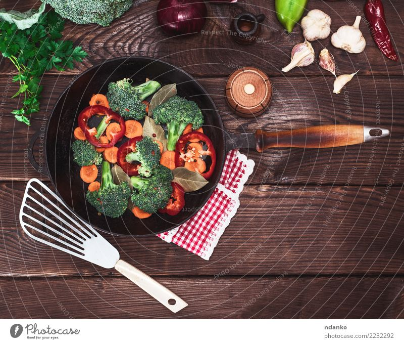 fresh vegetables in a black round frying pan Vegetable Nutrition Eating Vegetarian diet Diet Pan Table Kitchen Nature Plant Wood Fresh Natural Brown Green Red
