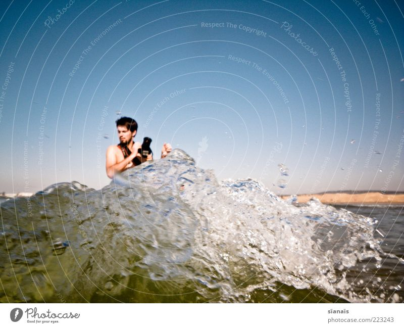 Human being Man Water Youth (Young adults) Vacation & Travel Ocean Adults Waves Fear Leisure and hobbies Tourism Masculine Swimming & Bathing Dangerous Elements Camera