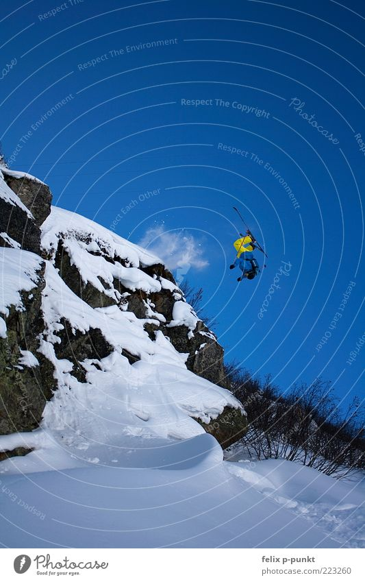 Human being Man Winter Joy Adults Yellow Snow Sports Mountain Happy Jump Style Rock Flying Masculine Skiing