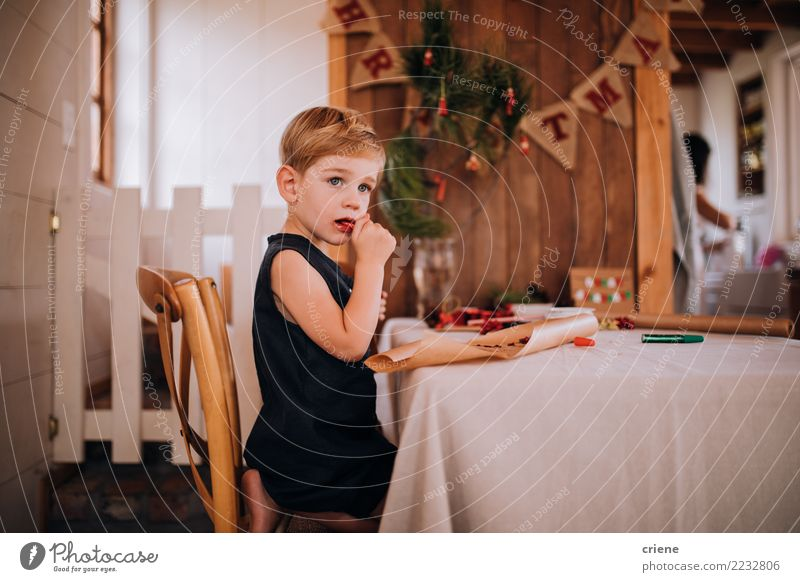 Caucasian little toddler eating christmas candy Child Christmas & Advent Winter Eating Boy (child) Infancy Creativity Table Gift Surprise Toddler Home
