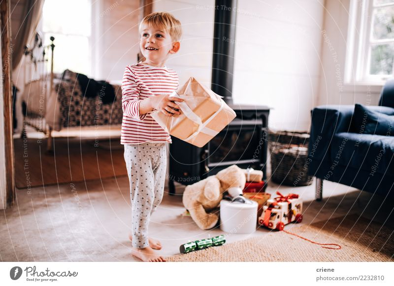 Excited little boy with christmas presents at home Joy Happy Child Toddler Boy (child) Infancy 1 Human being 1 - 3 years 3 - 8 years Toys Smiling Laughter Cute