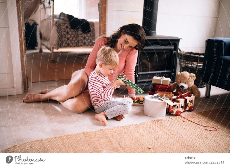 Mother and toddler son opening christmas presents Lifestyle Joy Happy Winter House (Residential Structure) Living room Christmas & Advent Parenting Child