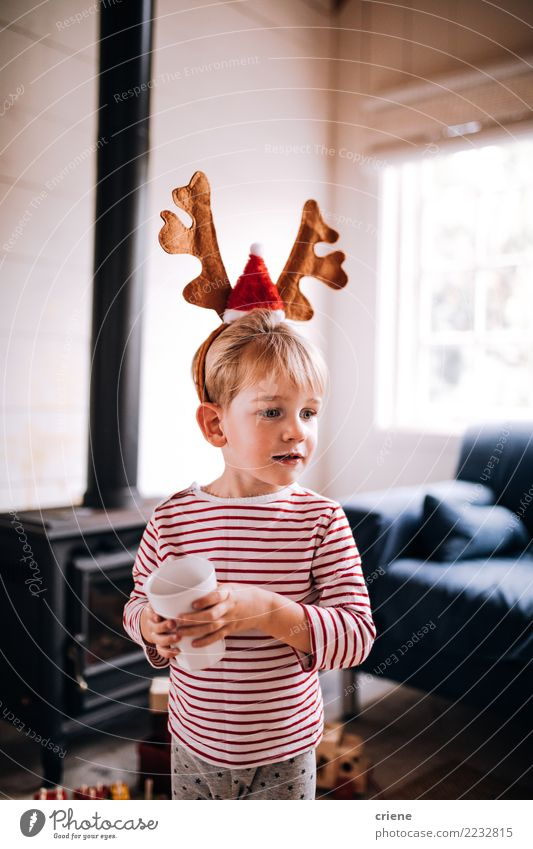 Cute toddler wearing reindeer ear costume on christmas day Drinking Lifestyle Joy Happy Winter House (Residential Structure) Living room Christmas & Advent