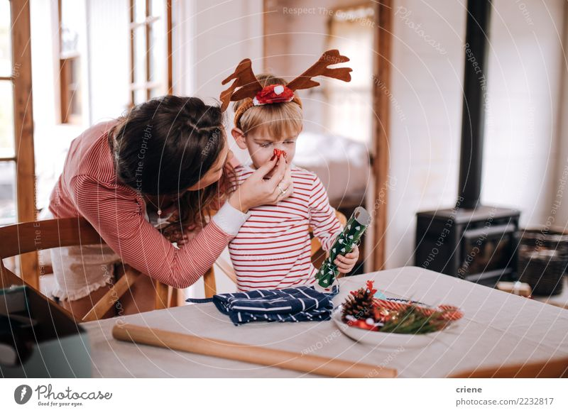 Mother and son putting christmas costume on Joy Happy Winter House (Residential Structure) Living room Christmas & Advent Toddler Parents Adults