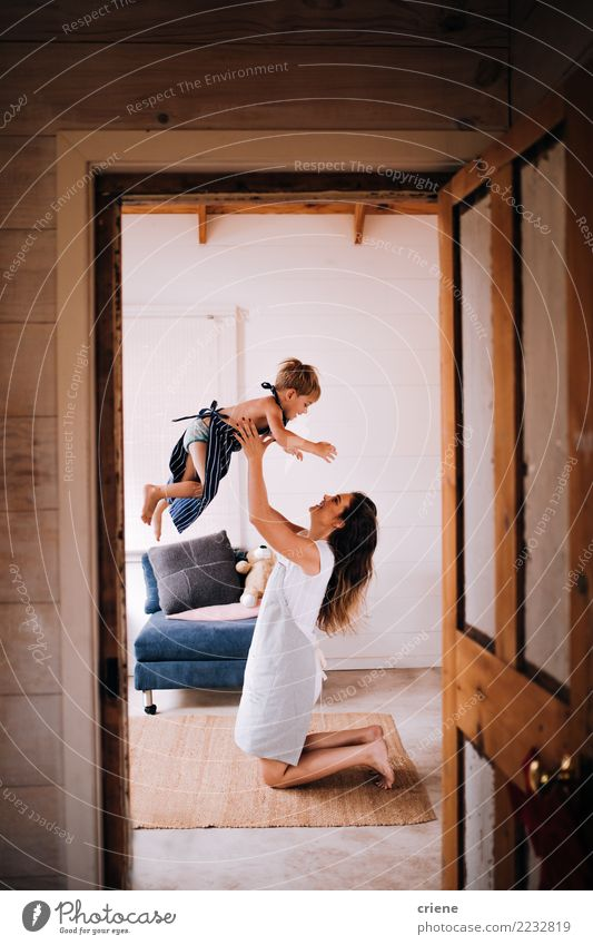 Young mom having fun with toddler son at home Woman Human being Youth (Young adults) House (Residential Structure) Joy Adults Lifestyle Love Family & Relations