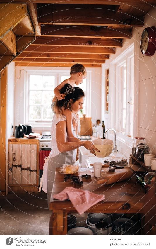 Mother and toddler son baking in the kitchen together Bowl Lifestyle Joy Happy Leisure and hobbies House (Residential Structure) Kitchen Parenting Child