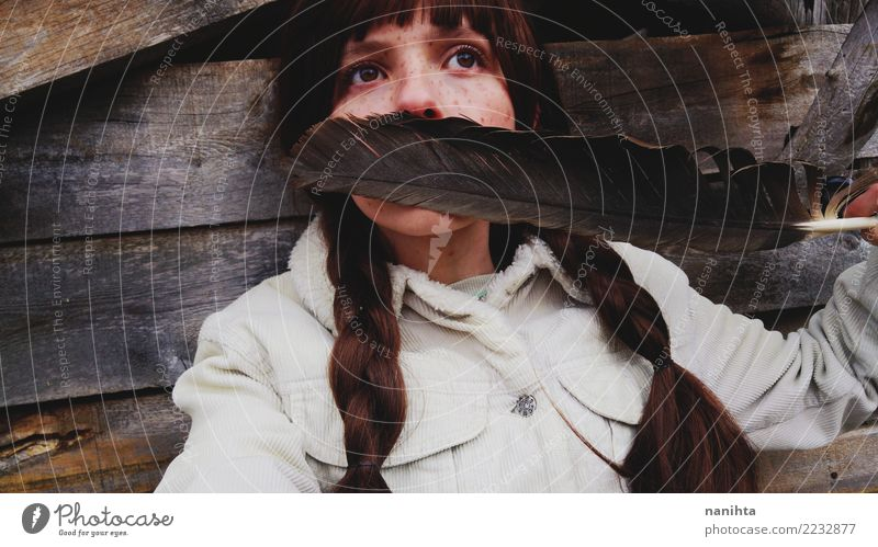 Young woman covering her face with a huge feather Design Exotic Beautiful Hair and hairstyles Skin Face Freckles Human being Feminine Youth (Young adults) 1
