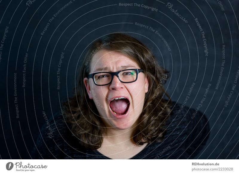 woman screams in front of a black wall Human being Feminine Young woman Youth (Young adults) Woman Adults Face 1 30 - 45 years Eyeglasses brunette Long-haired