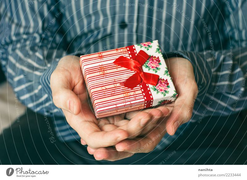 man's hands holding a gift box Human being Man Christmas & Advent Blue White Hand Red Joy Adults Love Happy Feasts & Celebrations Friendship Masculine Birthday