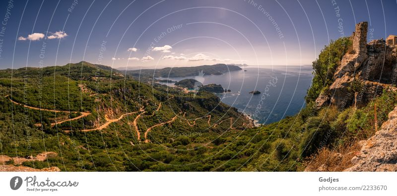 Nature panorama with a view of the Mediterranean Sea, a winding road and the ruins of Paleokastritsa Castle | Paleokastritsa Landscape Water Sky Clouds Horizon