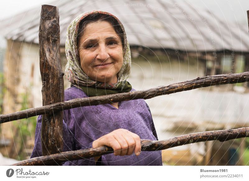 Portrait of an elderly Muslim woman in rainy day, rural area Lifestyle Style Vacation & Travel House (Residential Structure) Human being Feminine Woman Adults